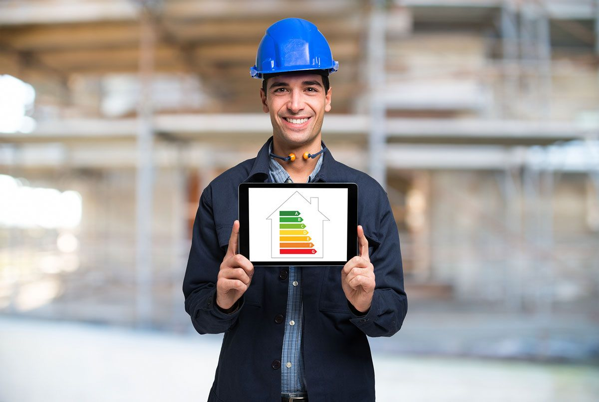 A builder holding a tablet with a energy rate guide